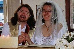 Peter holds Jana's hand as both laugh joyfully on their wedding day