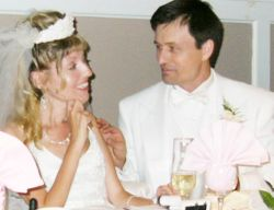 A bride teases her new husband from Ontario as he looks at her affectionately