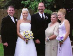 A man can't stop smiling after marrying a beautiful Christian woman as both are surrounded by family