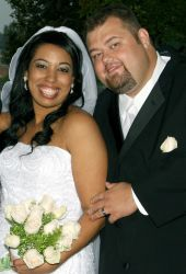 Cute Christian couple smile together on their wedding day