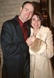 An overjoyed couple of Christian singles hold hands and smile after meeting