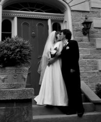 Dream wedding for Christian couple who kiss on the stairs outside church