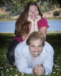 Giggles for couple photo shoot with wife on top of her husband's back