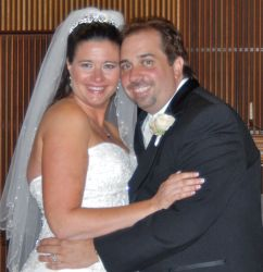 Happiest day ever for newly married Christians who hug and look very comfortable together