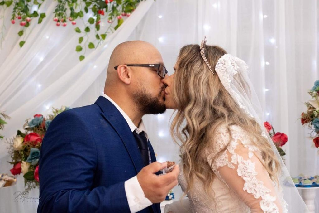 Attractive Christian couple kiss on their wedding day