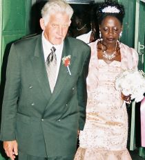 Newly married Christians walk hand in hand after marrying