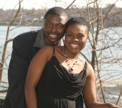 A NY Christian couple hug tightly and laugh together by the water in April