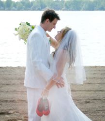 Christian newlyweds gaze into each other's eyes by the Great Lakes