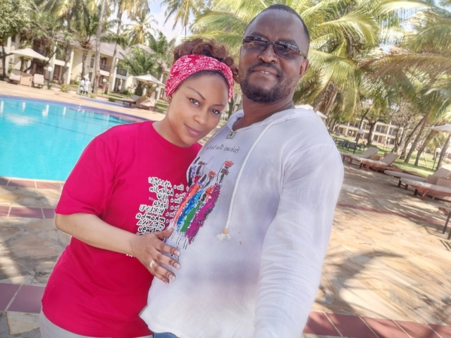 Beautiful Christian couple in front of pool at resort in Tanzania