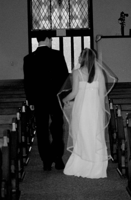 Sandra and her husband on their wedding day, 7 years ago.