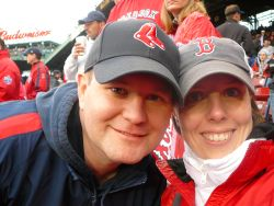A happy couple at a Red Sox game
