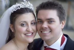 Beautiful Christian couple from England smile cheek to cheek after marrying