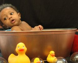 Cute baby in tub with ducks