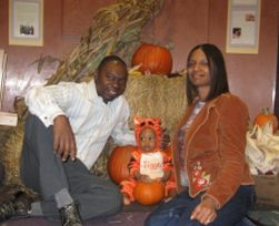 Christian couple still in love pose at Halloween with their little boy