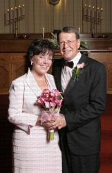 A very happy Christian bride stands next to her elated husband in the church