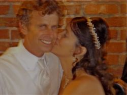 A joyful Christian man receives a kiss on the cheek from his loving wife