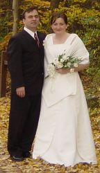 Happy Christians from Ohio and Romania stand proudly together for their Autumn wedding