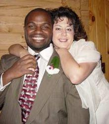 A man looks very joyful as a Born again Christian woman hugs him from behind