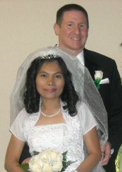 Christian couple smiling while standing