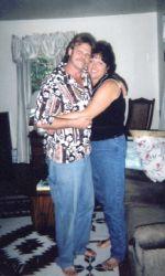 Born again Christians hug in the living room