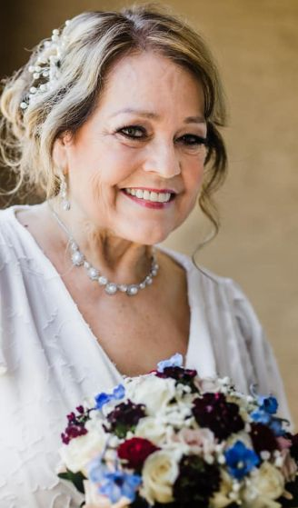 Beautiful senior Christian bride smiling holding bouquet