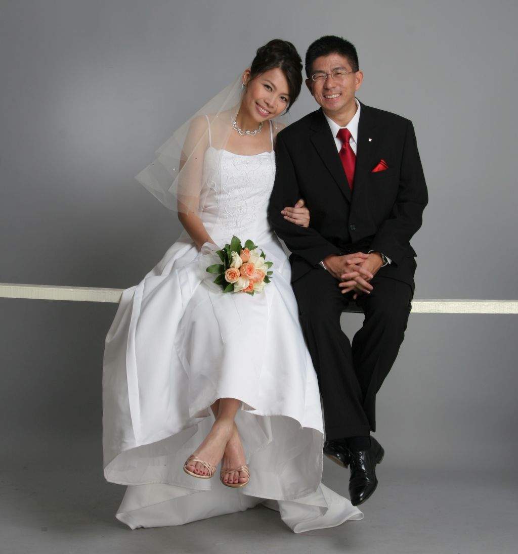 A new bride and groom look very comfortable together. American single meets woman in Malaysia