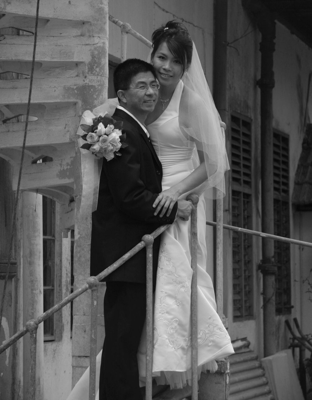 Man on stairs holding his beautiful Christian bride