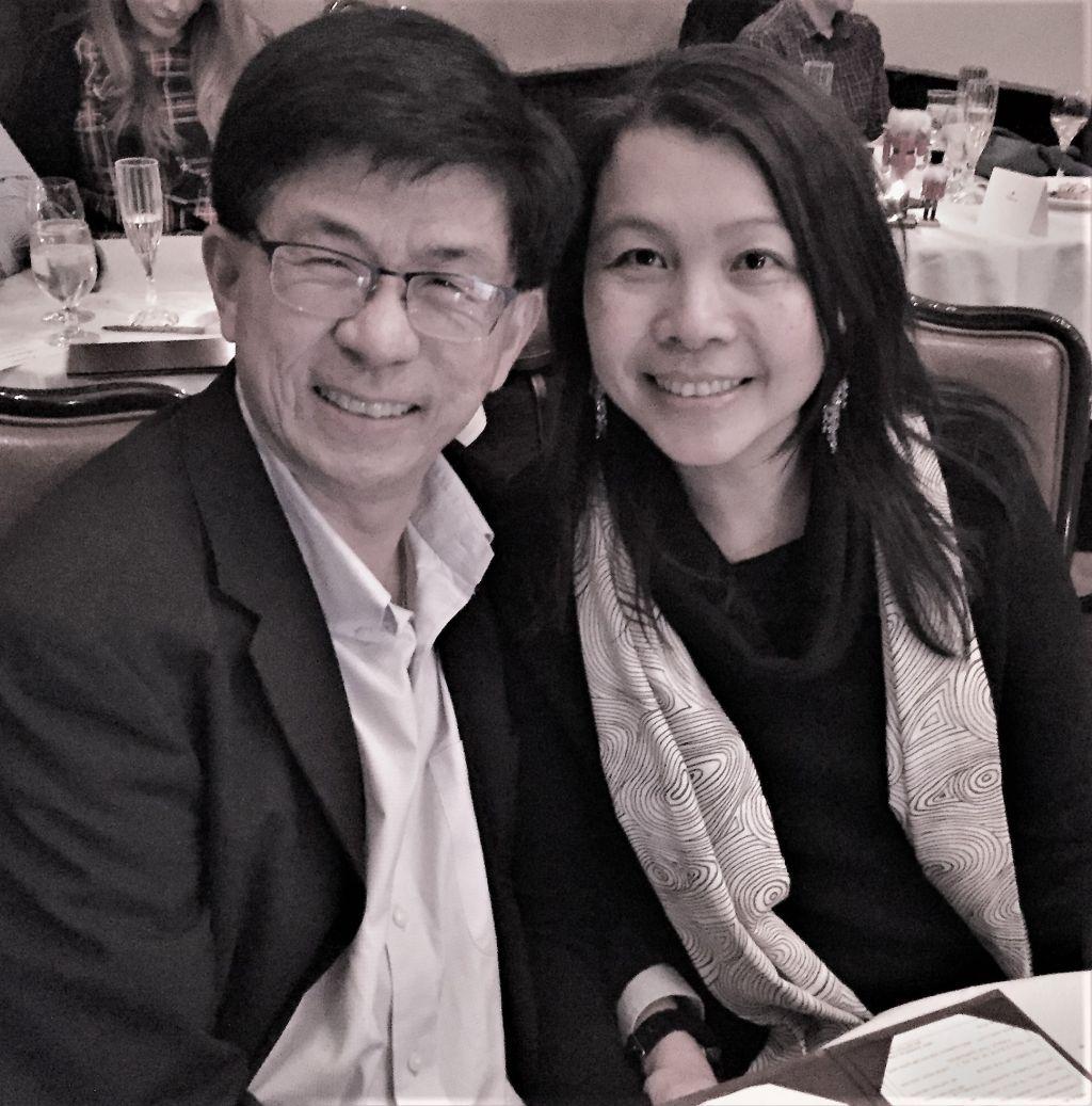 Joyful Christian couple smiling while dressed up for dinner