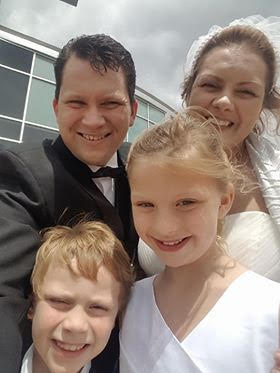 Blended Family selfie for newly married couple and their smiling children