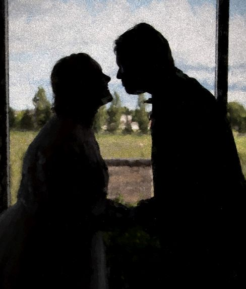 Silhouette of former Christian singles from Minnesota about to kiss