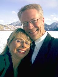 Newly engaged Christian singles smile together in beautiful mountain scenery