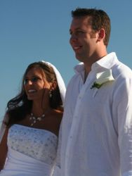 A tall Christian man from California stands next to his beautiful and joy filled bride