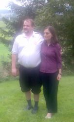 Terje and Raluca on the grass full of joy
