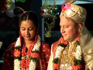 Christian couple in flowers for traditional Indian wedding