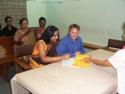Interracial couple sign wedding license