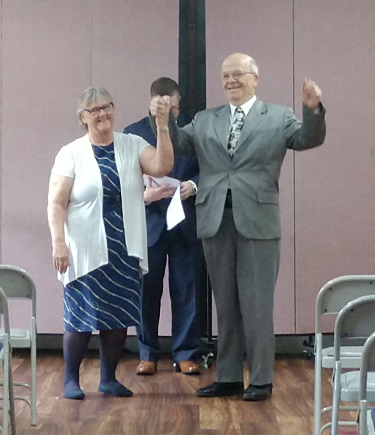 ex-single Christians raise their hands triumphantly after marrying