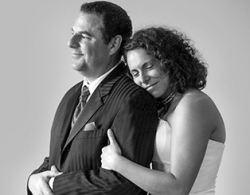 Former Christian single woman from Wisconsin looks calm as she hugs her husband