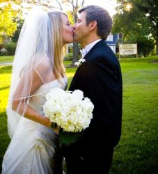 A beautiful woman kisses groom on their Wedding day