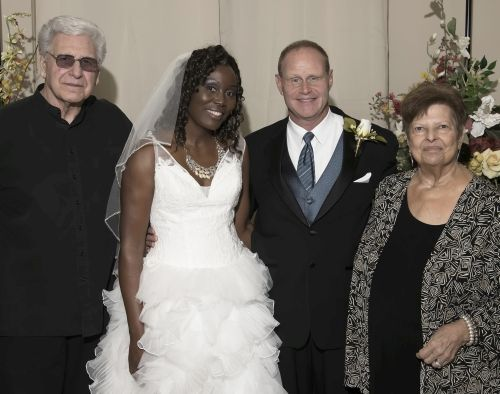 Wedding shot of smiling bride, groom and his parents