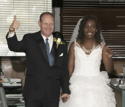 Thumbs up for this wedding indicated by excited groom who holds his beautiful brides hand