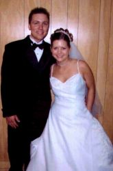 Born again Bible Believing Christians smile together on their wedding day