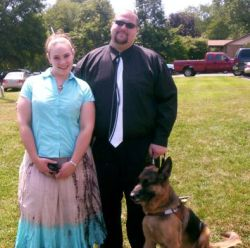 Groom with a seeing eye dog smiles while standing next to his beautiful Christian fiancee