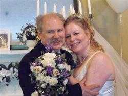 An overjoyed Christian man hugs his new bride