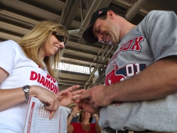 Christian single puts an engagement ring on his excited new fiancee at a Red Sox game