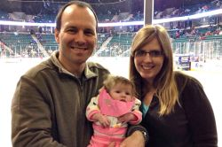 Trina, Kevin and Faith at a hockey game