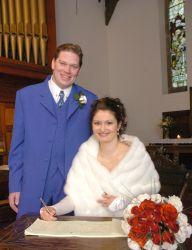 Signing wedding license on their wedding day