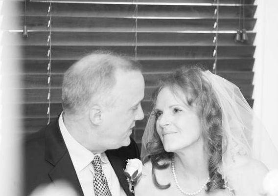 Victoria looking lovingly into Joe's eyes at their wedding