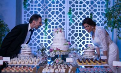 Excited couple preparing to cut Wedding cake