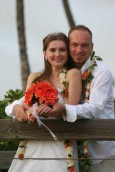 Hawaiian Christian singles marry and pose on a bridge