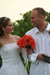 Christian couple laughing at their wedding